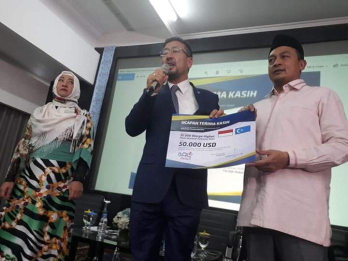 Muslim Uighur Bantu Korban Tsunami Selat Sunda 50.000 USD